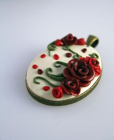 Polymer Clay Antiqued Rose pendant. $25.00, via Etsy.