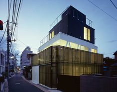 atelier A5: sn.house  by partially encasing the structure in a perforated metal screen, the home which is located in a densely populated neighborhood in tokyo, gains a sense of privacy that is shielded from street traffic and neighboring structures.