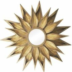 "Metal wall mirror with a starburst frame.  Product: Wall mirror Construction Material: Metal and mirrored glassColor: GoldFeatures:   Charming designWill enhance any setting Dimensions: 36"" Diameter"