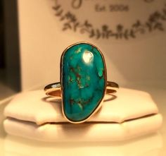 A personal favorite from my Etsy shop https://www.etsy.com/listing/534607863/freeform-turquoise-ring-gold-turquoise