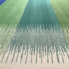 A colourful blue and green rug with white borders Hand-dyed and woven using a special ikat technique. A flatweave rug in wool. Types Of Weaving, Weaving Tools, Weaving Projects, Loom Weaving, Hand Weaving, Weaving Designs, Weaving Patterns, Knitted Cushions, Lotus Design