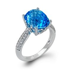 Marvelous and posh, this 14K white gold ring is a dazzling piece from our Vintage Vixen Collection and is created with .33ctw round white diamonds and a 7.70ct Blue Topaz .