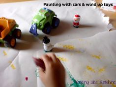Painting with wind up toys and cars! Fun idea from Smiling like Sunshine