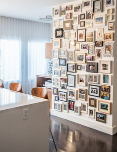 Fill an entire wall with framed pictures