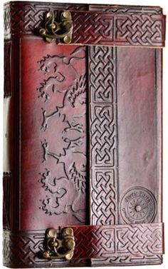 "Hand tooled blank leather journal with embossed Celtic designs. Exact embossing will vary. Sizes vary slightly. Leather, handmade paper. 220 pages, latch closure. 5 1/2"" x 9"""