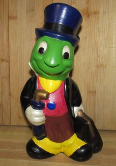 This statue of Jiminy Cricket was molded from a Walt Disney approved mold.I painted him some time in the
