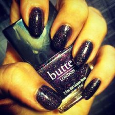 """Butter London, """"The Black Knight"""" pink, blue, silver and black glitter in a black base."""