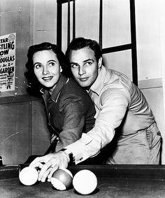 Marlon Brando teaches to Teresa Wright how to play billiard on the set of The Men,1949.