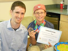 Children's Cancer Connection participant receiving a medal from Medals4Mettle - Des Moines Chapter