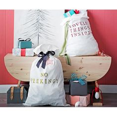 Transform a plain white pillowcase into a DIY Santa sack for Christmas. They're a great alternative to stockings if you don't have a mantel.