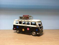 Vintage black hippie van with painted flowers