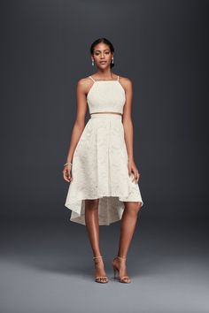 For a casual city hall or elopement, a Two-Piece Lace Wedding Dress with High-Low Skirt by Harlyn available at David's Bridal