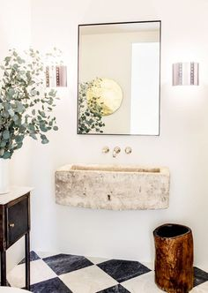 In the powder room of her LA spec house, Leigh Herzig paired tadelakt walls with an antique limestone trough sink and vintage black-and-white tiles. Photograph by Laure Joliet, courtesy of Leigh Herzig. Bad Inspiration, Decoration Inspiration, Bathroom Inspiration, Interior Inspiration, Bathroom Ideas, Bathroom Vanities, Washroom, Bathroom Designs, Bathroom Remodeling