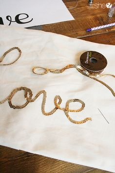 Gold Sequin Word Script Pillow   How Does She
