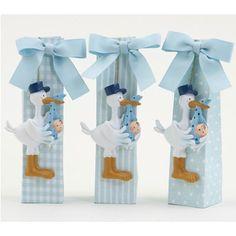 Detalles para fiestas de nacimiento y bautizos. Set de Cigüeñas con peladillas de chocolate.