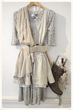 Myrine waistcoat/ tunic, £121 Myrine flower print tee, £37.50 Myrine flower print skirt, £29 Sandwich scarf, £35 Belt, £41 Strata necklace, £35 Unisa boots, (was £182) £79.95  http://www.exivboutique.co.uk/
