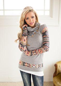 Light weight long sleeve sweater featuring aztec print sleeves along with buttons up the neck. This is the perfect sweater to transition into spring with. A spl