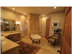 Corner shower and claw-foot tub