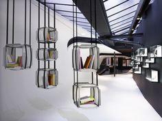 la bibliothèque suspendue upside down by designer adrien de melo