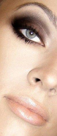 Brown and black smokey eyes, perfect make up .