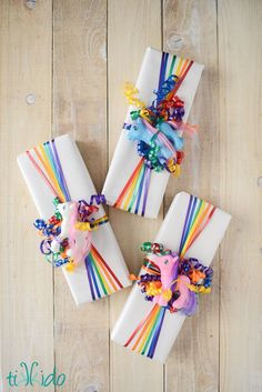 Easy rainbow ribbon gift wrap tutorial, using inexpensive curling ribbon.  Great for a rainbow party, My little Pony party, etc.