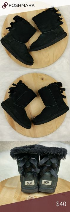Ugg Australia Bailey bow girls black boots size 3 Ugg Australia Bailey bow girls black boots size 3 Very warm genuine sheep skin upper and lining In good condition. Has some normal wear. UGG Shoes Boots