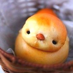 Chick Bread - perfect for Easter Brunch. Stack two balls of bread together. Insert two raisins for eyes and a nut for the beck. So cute!