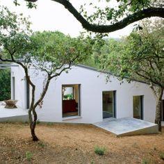 Maison sur un terrain en pente - H arquitectes