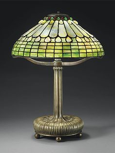 A JEWELED FEATHER LEADED GLASS AND BRONZE TABLE LAMP, CIRCA 1910