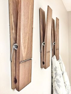 What a unique and fun way to hang your towels in your bathroom or laundry room. Can also be a fun way to display photos, kids drawings, or notes in your home, nursery or office with a large rustic decorative walnut stained clothespin. Customize your clothespin with your name or