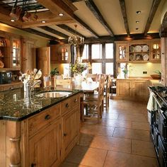 Modern rustic farmhouse #kitchen. Love the exposed ceiling beans.