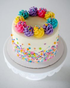A rainbow cake is fun to look at and eat and a lot easier to make than you might think. Here's a step-by-step guide for how to make a rainbow birthday cake. Pretty Cakes, Cute Cakes, Beautiful Cakes, Amazing Cakes, Stunningly Beautiful, Decoration Patisserie, Birthday Cake Girls, Colorful Birthday Cake, Cupcake Ideas Birthday