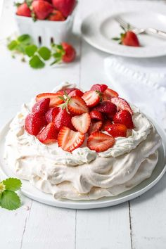 Strawberry & Mascarpone Pavlova Recipe ~ the outside is crisp and sweet with a soft marshmallow-like center. Traditionally served with whipped cream and fresh fruit, the Pavlova is a popular dessert in Australia and New Zealand. Strawberry Pavlova, Strawberry Recipes, Oreo Dessert, Eat Dessert First, Köstliche Desserts, Dessert Recipes, Plated Desserts, Gourmet Recipes, Sweet Recipes