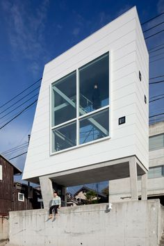 This tiny seaside home is contained within little more than a pair of oversized windows raised up on stilts
