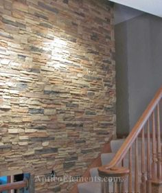 Stairway with faux stone wall panels - Good long term solution to avoid having to paint/paper a space with a high ceiling while providing visual interest/texture and sense of solid structure. Faux Stone Wall Panels, Faux Stone Walls, Stacked Stone Walls, Stone Accent Walls, Manufactured Stone, Home Goods Decor, Stone Veneer, New Wall, Stairways