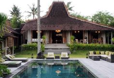 """""""The former focus on an antique Javanese Joglo is the main dining room, living room, and decorating with art from all over Indonesia"""""""