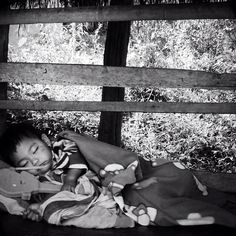 """""""#blackandwhite #bw #photooftheday #picoftheday #southeastasia #thailand #travel #travelphotography #children - taken somewhere between Chiang Mai and Pai (2011) - little boy sleeping while mother sells souvenirs"""" Photo taken by @actuallymt on Instagram, pinned via the InstaPin iOS App! http://www.instapinapp.com (09/30/2014)"""