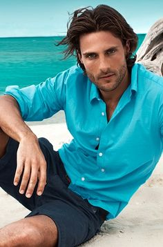 Opt for an aquamarine longsleeve shirt and dark blue shorts to effortlessly deal with whatever this day throws at you.  Shop this look for $64:  http://lookastic.com/men/looks/aquamarine-longsleeve-shirt-and-navy-shorts/2655  — Aquamarine Longsleeve Shirt  — Navy Shorts