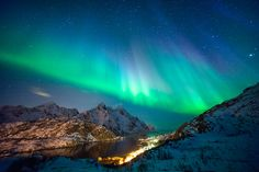THE NORTHERN LIGHT TOWERING ABOVE THE TOWN OF LOFOTEN, NORWAY, 2014