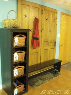 DIY mudroom with hooks on old doors, bench and shelves with baskets. (just different colors)--OLD DOORS FOR WALL Basket Shelves, Baskets, Up House, House Doors, Farm House, Old Doors, Kitchen Redo, Handmade Home, Mudroom
