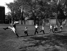 """he photo was taken by Alfred Eisenstaedt, who was covering the University of Michigan's marching band. When some children playing nearby set off after this practicing drum major, he snapped the photo. Said Eisenstaedt, """"This is a completely spontaneous, unstaged picture."""" via kottke.org"""