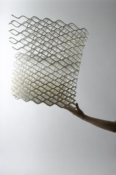 "Japanese design studio Nendo made this 3D printed Diamond Chair (above and below) with their concept of ""elastic yet strong"" in mind. This chair is made from nylon, yet is much stronger than it appears. Thanks to its structure, the seated person's weight is distributed among the entire chair."