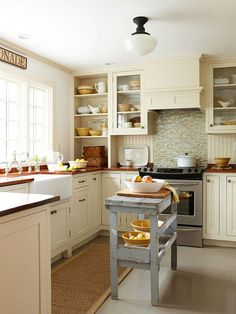 Dark color schemes shrink an already small space and make it less inviting. Use soft shades on kitchen cabinets and natural light to visually expand a small room. BUT... if you want a warm cozy kitchen and yours is small, then go for the warm wood tones - sometimes getting what you love means breaking the rules! Love the backsplash. Different textures
