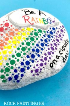 These rainbow painted rocks make fantastic kindness rocks. This tutorial will walk you through how to create this fun dotted rock painting idea. Use this dotted rock for hiding, giving as a gift, or decorating your home or office. #dotted #rainbow #paintedrock #kindnessrocks #rockpainting101 Rock Painting Ideas Easy, Kindness Rocks, Crafty Craft, Stone Painting, Painted Rocks, Decorating Your Home, Dots, Rainbow, Good Things