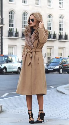 Nada Adelle wears a gorgeous fur trimmed beige overcoat with strappy black sandals and a matching simple tee. This look is ideal for every day sophistication and glamour. Coat: Primark, Bag: Runway...