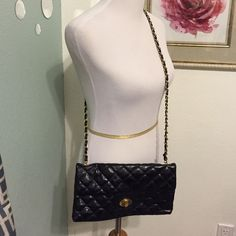 Black Quilted Crossbody/Shoulder Handbag Pretty black classic quilted handbag. Can be worn Crossbody or on shoulder. Gold chain detailing with turn lock and zipper closure. In EUC other than a bit of discoloration on turn lock closure. Pretty floral inside lining with zip compartment.  Bags Crossbody Bags