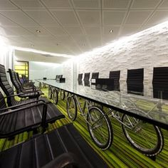 Fun conference room table with LED strip lighting around the edges of the room #LED #biking
