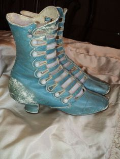 Rare Robins Egg blue High boot Victoian ca 18801890 Talk about a fabulous color! I have never seen any old boots in this shade. These are rare and were from a museum collection. The buttons are milk glass and the kidd leather is soft to the touch. Unique openings in the front and in fairly good shape.They would make a lovely display for any antique shoe collector. These date between late 1880's to 1890.