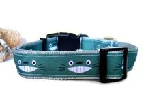 MY NEIGHBOR TOTORO DOG COLLAR  100% handmade. Adjustable collar, comfortable and stylish for your best friend.  Available in the measure of: 1 of width. The dog collar are realized in polypropylene webbing, lasting and soft, with a cartoons ribbon. Each dog collar features a heavy duty plastic side release buckle as well as a metal D ring and slider. All our dog collars have a straight stitch, for a good reinforcement of the fabric and also reinforced in the different attachment points…