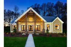 Rustic timbers with stone bases frame a soaring entry to the Pikes Peak plan. New homes built on your lot by Schumacher Homes. Charlotte, NC.